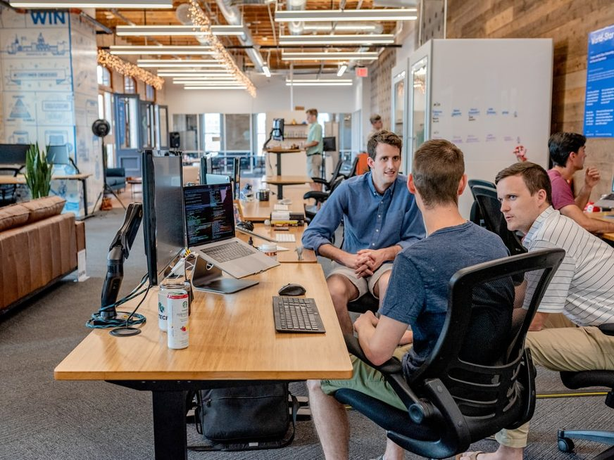group of men collaborating at office
