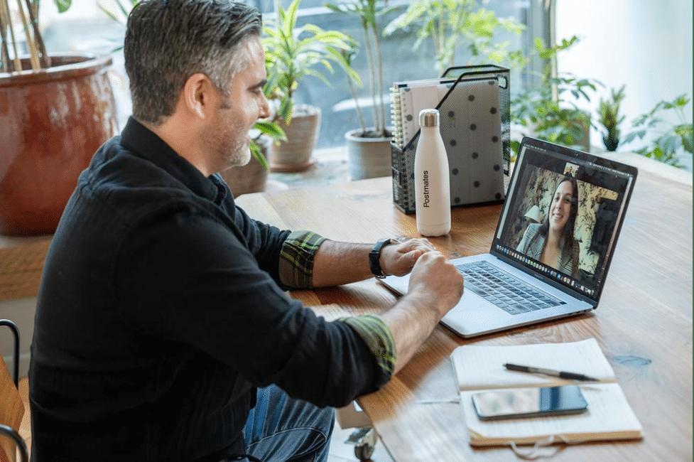 Man at desk having virtual conference call